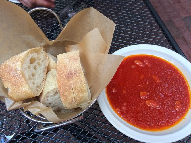 Stretch bread and hot tomato oil served at dinner.