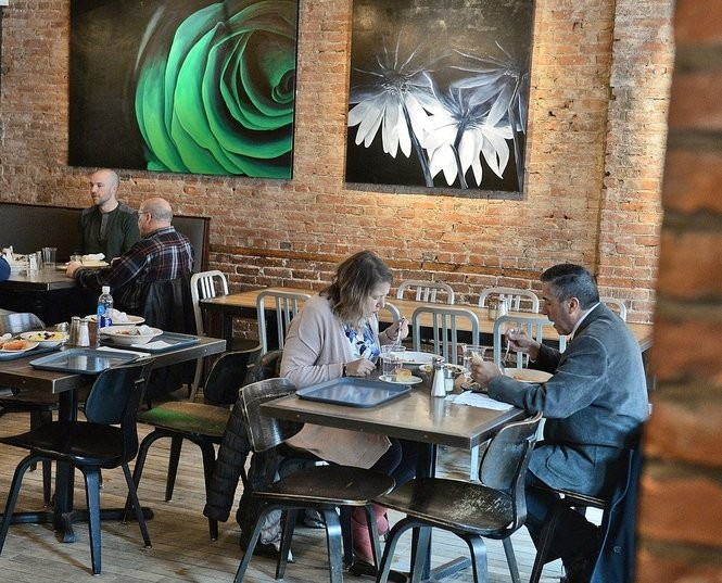 Customers eat in the side dining area during the lunch hour. Michael Greenlar | mgreenlar@syracuse.com