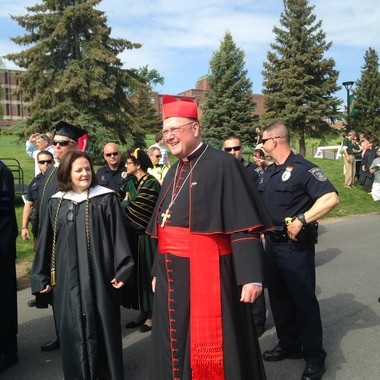 Cardinal Timothy Dolan at Le Moyne commencement ceremonies Sunday.