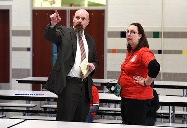 Mike Collins talks with principal Carin Reeve-Larham in the cafeteria. Collins is the director of the Northeast Community Center next door to Dr. Weeks Elementary School on Hawley Avenue.