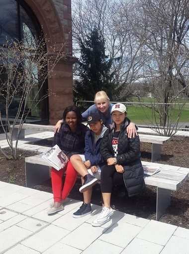 Joyce Suslovic with Henninger High School students during a college visit in Boston.