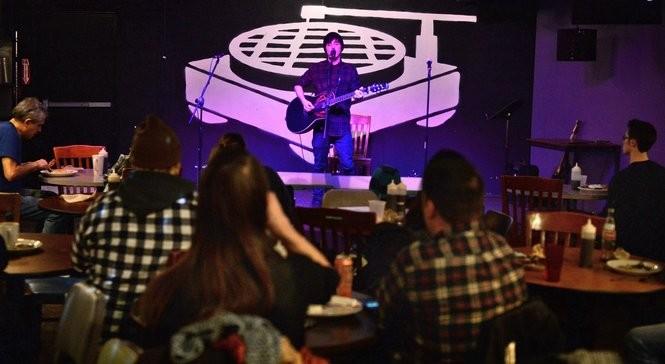 The crowd at Funk'n Waffles on open mic night. The Marshall St. block at Syracuse University, Wednesday Jan. 25, 2017. (Michael Greenlar | mgreenlar@syracuse.com)