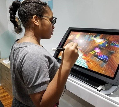 A Syracuse student builds a custom virtual reality wrist watch using zSpace glasses and a stylus to manipulate a 3D image produced by the screen.