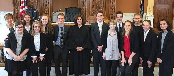 The winning Mock Trail team from Cazenovia High School poses in the courtroom.