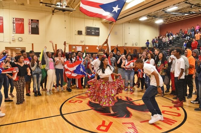 Students celebrate Puerto Rican heritage in the gym. The opening ceremony for the Multicultural Festival at PSLA Fowler High School, May 25, 2017.