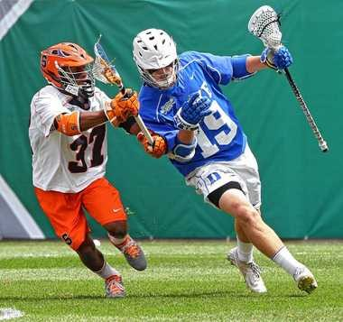 Syracuse's Drew Jenkins guards Duke's Christian Walsh during the NCAA Championship game in Philadelphia. The two teams will be part of a potent lacrosse league in the ACC.