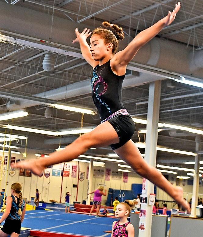 Antoinette Sakellariou, 10, practices on the beam.