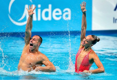 Gold medalists Bill May (left) and Christina Jones (right) from the US compete during the synchronised swimming mixed duet technical final at the Swimming World Championships in Kazan, Russia, Sunday, July 26, 2015