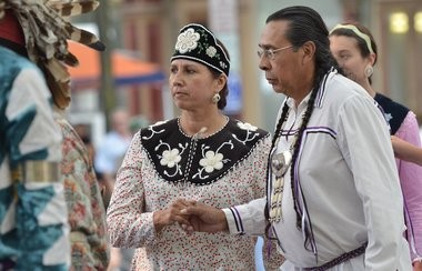 Sherri Waterman and Tadodaho Sid Hill dance with the Haudenosaunee Singers and Dancers in Hanover Square, Syracuse in this 2014 file photo.