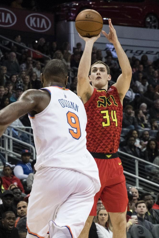 Atlanta Hawks forward Tyler Cavanaugh (34) shoots as New York Knicks center Kyle O'Quinn (9) defends during a NBA basketball game, Friday, Nov.24, 2017, in Atlanta. (AP Photo/John Amis)