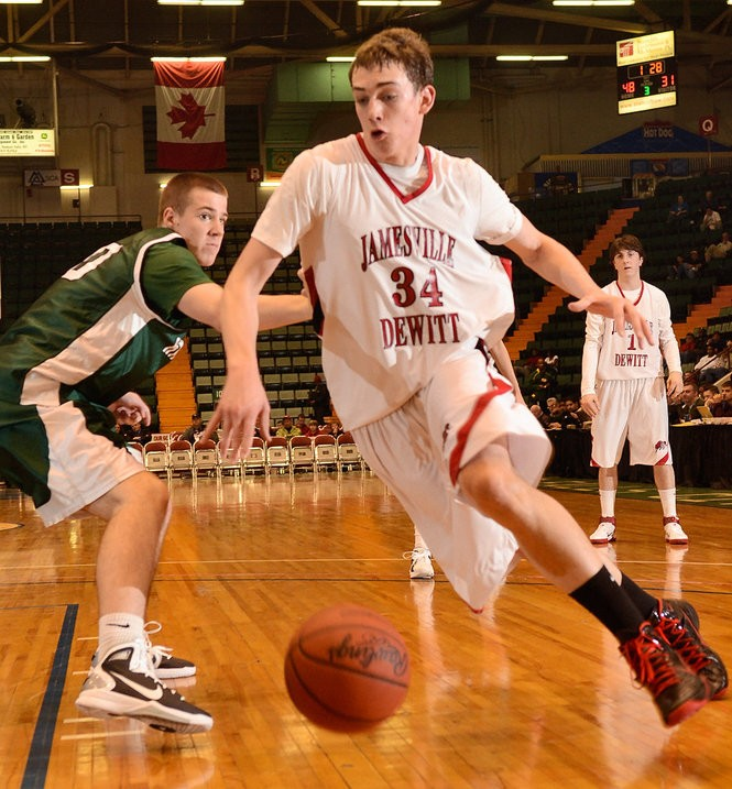 Jamesville-DeWitt's Tyler Cavanaugh drives to the basket against Harborfields in the New York State Public High School Athletic Association Class A basketball final in the Glens Falls Civic Center on March 20, 2011. J-D won 66-51.