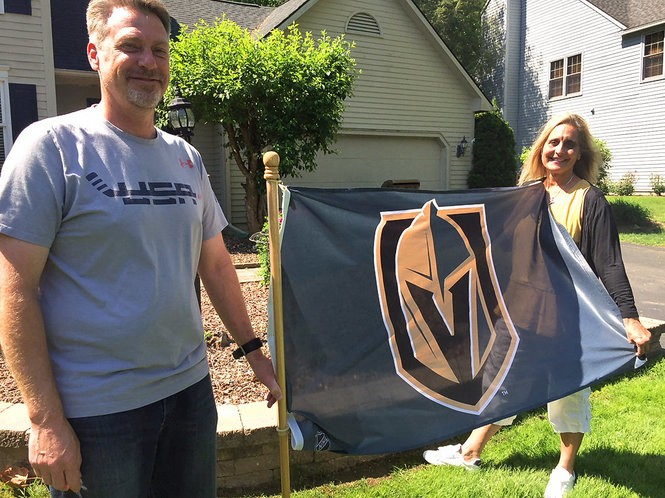 Carl and Sharon Tuch with a Golden Knights flag in front of of their Baldwinsville home.