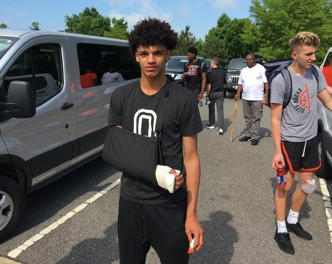 Class of 2020 forward Andre Jackson, fresh from an injury to his wrist, wears a soft cast and a sling. He's in the parking lot of the Boo Williams Sportsplex, where his Albany City Rocks played its EYBL games. May 2018