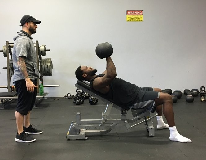 Trainer Vinny Scollo helps Minnesota Vikings running back (and Syracuse native) Latavius Murray during a Thursday exercise. July 12, 2018