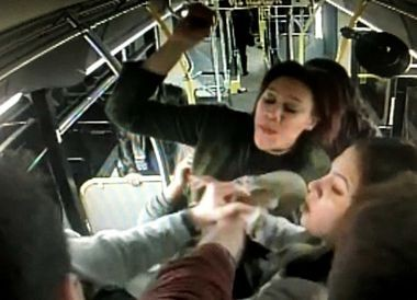A still from a security camera video showing an assault on an Albany bus.