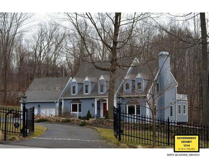 This evidence photo shows the house at 2 Millstone Lane, South Salem, Westchester County, that Joe and Lisa Percoco purchased in July 2012. According to FBI testimony, the mortgage on the house was about $800,000. Prosecutors have said the Percocos were under financial stress.