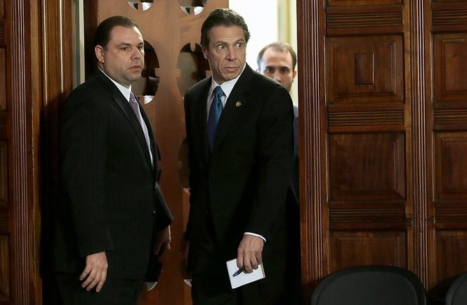 Gov. Andrew Cuomo, right, and Joseph Percoco, Executive Deputy Secretary, are seen at a press conference in 2013. Percoco is on trial for alleged bribery and extortion.