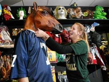 Customers try on costumes at the previous Dougherty's Masquerade location on Erie Boulevard in a file photo.