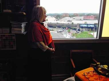 Marilyn Higgins, vice president of community engagement and economic development at Syracuse University, looks out her window onto the entrance to Armory Square from the Near Westside.