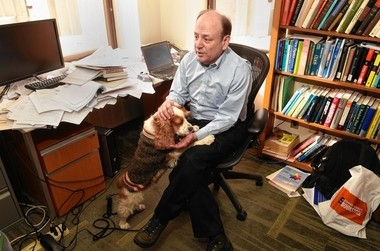 Syracuse University physicist Peter Saulson in his office with his dog Ruby, Michael Greenlar | mgreenlar@syracuse.com