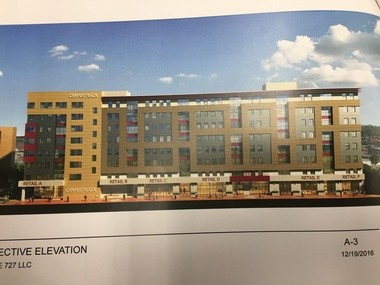This rendering shows the proposed 8-story retail and apartment building that would replace the existing plaza in the alleyway at 727 S. Crouse St. near Marshall Street and the Syracuse University campus. The plaza currently houses such shops as Chuck's Cafe, AppeThaizing and Funk 'n Waffles.