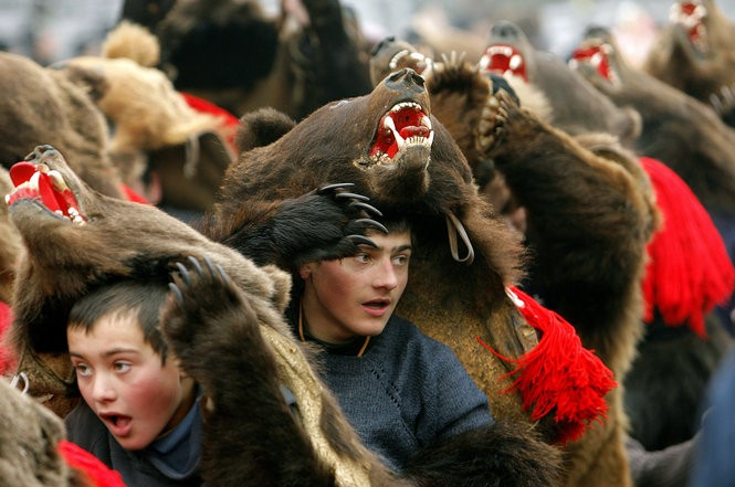Romanian children dance covered in a bear furs during New Year rituals in Comanesti, 300 kilometers north of Bucharest, Romania, Sunday Dec. 30 2007.