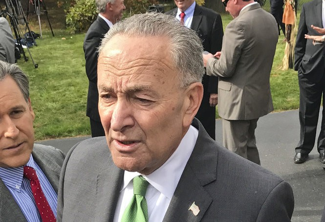 U.S. Sen. Charles Schumer addresses reporters after holding a news conference with New York Gov. Andrew Cuomo Monday, Oct. 23, 2017, in Bethlehem, N.Y.