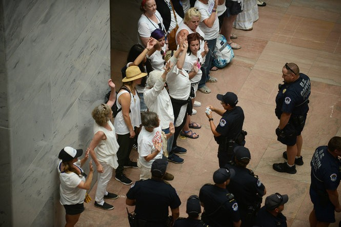 Capitol Police process a group consisting mostly of women demonstrators inside the Hart building in Washington, D.C.