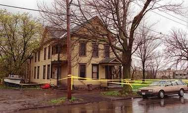 Two men were shot dead and another wounded April 21, 2000 during a robbery at a gambling den at this house at 222 Burt St. in Syracuse, N.Y. A gun used in the robbery was stolen from then-Assistant U.S. Attorney John Katko, who is now running for Congress in the 24th Congressional District.
