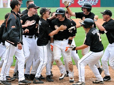 Mexico catcher Kody O'Connor shares in the celebration with his teammates as he crosses home plate after hitting a game winning three run homer in the bottom of the seventh inning to beat Massena 5 to 2 Monday in the Class A state regional baseball game at Alliance Bank Stadium. Lauren Long / The Post-Standard