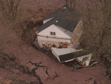 Tully Farms Rd home of June Horton and Dennis Reid surrounded by mud and clay after mudslide hit on April 27, 1993.