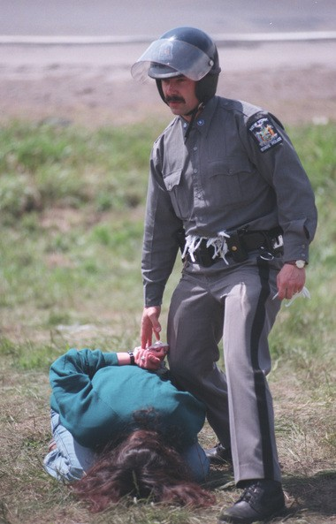 New York State Police arrest Native Americans at the Onondaga Indian Reservation during a protest over a tax deal. Photo taken on May 18, 1997.