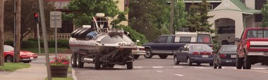 Rick Dobbertin drives his amphibious vehicle, the Surface Orbiter in Manlius on his way to taking it for storage in Syracuse in June 2000.