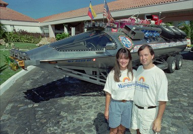 Karen and Rick Dobbertin pose with their homemade amphibious craft on Dec. 14, 1994 in Puerto la Cruz, 170 miles east from Caracas, Venezuela after completing the first year of their journey.