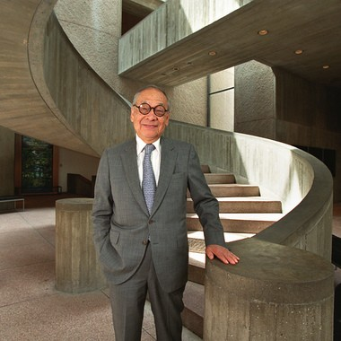 Famed architect I.M. Pei, designer of the Everson Museum, visits the museum in 2000. He's standing at the foot of the spiral staircase in the museum's main hall.