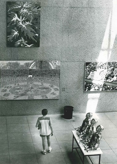 A visitor walks through the exhibits at Syracuse's Everson Museum in July 1974.