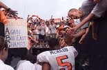 SU's Donovan McNabb runs back to the locker room after leading the Orange to a 38-28 upset win over Michigan.