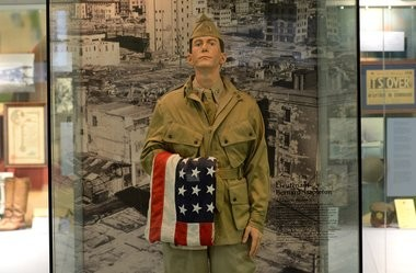 A figure of Lt. Bernard Stapleton stands at an exhibit at the Onondaga County War Memorial honoring veterans of Syracuse and Onondaga County.