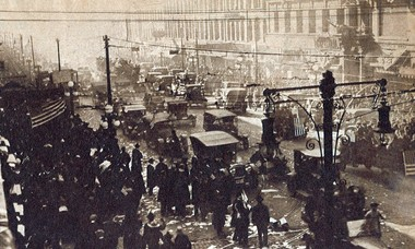 Street cleaners work to clean Syracuse streets following celebrations after the end of World War I. Scene is looking south on Salina from Fayette.
