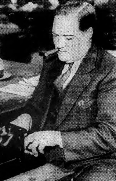 Deputy Sheriff Raymond Guilfoyle is seen working at his typewriter. His hunch that farmer McGann had been murdered proved correct.