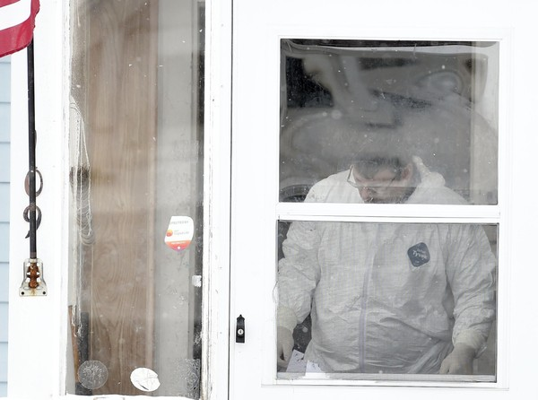 Syracuse police technicians work inside 109 Charmouth Drive in Syracuse while investigating the Jan. 13, 2016, fatal stabbing of David Jones. Jones, 43, was one of the 30 homicide victims killed in Syracuse in 2016.