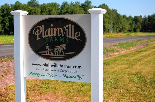 The sign outside the Plainville Farms turkey-raising operation on Plainville Road in Lysander. Farmer Josh Allen is raising about 500,000 turkeys a year for Plainville's parent company, Hain Celestial Group.