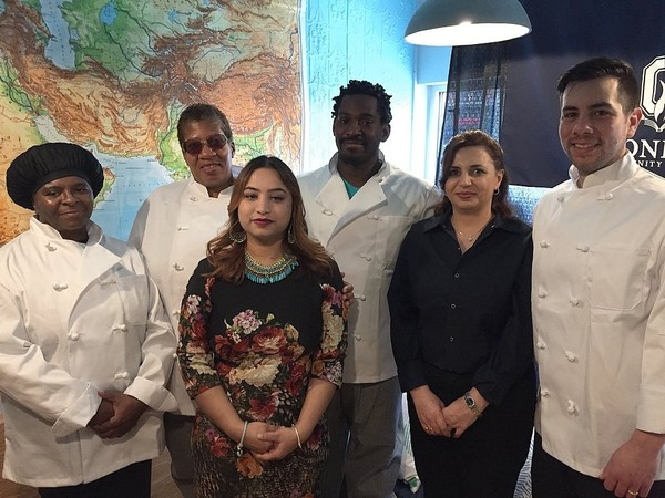 Members of the first class of students to learn and work in Onondaga Community College's North Side teaching restaurant, With Love, Pakistan. From left: Delores Jones, Venus Likulumbi, Sarah Robin, Trenton Peterson, Rania Asfour and their culinary instructor, chef Chris Muniz.