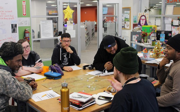 Patrons gather in the Central Library MakerSpace on Dec. 7, 2018 to learn the fundamentals of the game Dungeons & Dragons.