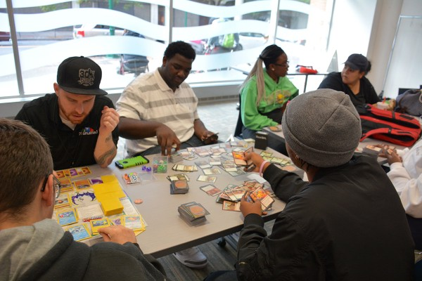 Teens play Pokemon and Magic the Gathering card games at a TCG Player event at the Central Library on Oct. 12.