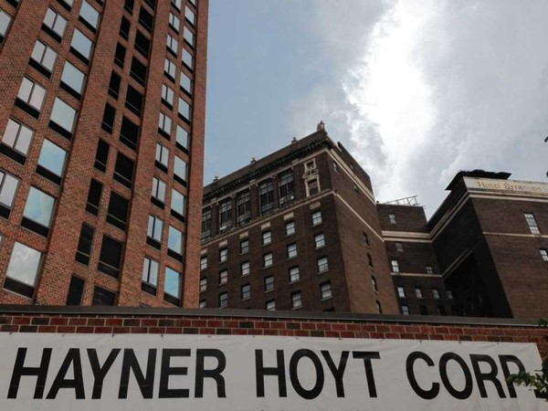 A Haynor Hoyt Corp. official says the company will drop plans to complete the transformation of the Hotel Syracuse tower, left, into apartments because of a recent ruling by New York's Court of Appeals. The historic section of the Hotel Syracuse is at the right. The hotel closed in 2004.