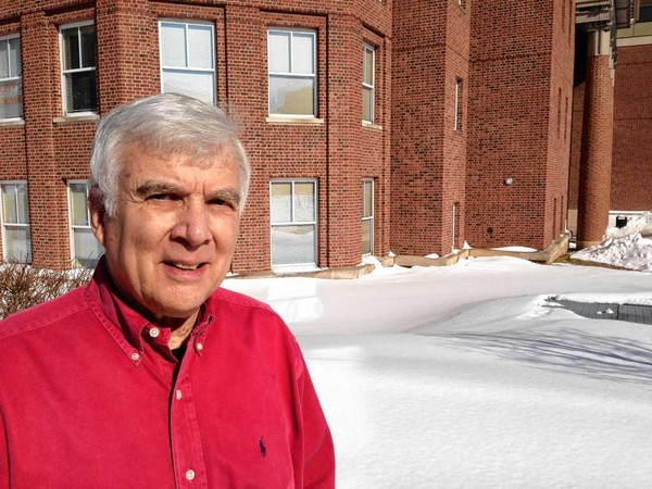 Syracuse University geography professor Mark Monmonier, who wrote a book on lake effect snow, stands outside Eggers Hall after a recent snowstorm.