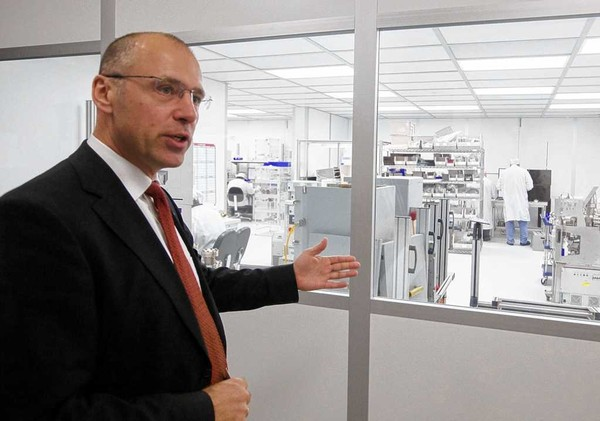 Peter Maier, president of Inficon, stands outside a cleanroom in Inficon's manufacturing area in DeWitt. A cleanroom controls the environmental pollutants in a defined space. Some of Inficon's instruments are manufactured under cleanroom conditions to assure quality. The company, which exports worldwide, wants to expand in DeWitt.