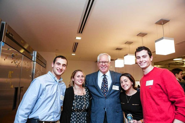 Carl J. Schramm is shown with Syracuse University alumni and students during a November 2013 trip to Boston on an entrepreneurship immersion trip involving SU's School of Information Studies. Schramm, center, was the keynote speaker. He is flanked by, from left, Neil Winston '14, Janelle Bridson '13, Sara Bendetson '12, and Max Greenberg '14. The event was at the Start Tank, located in PayPal's Boston offices.